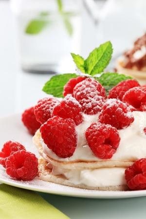 Pancakes with sweet cream cheese and raspberries photo