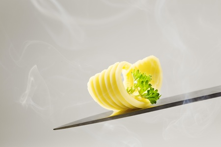 Butter curl on a knife - studio Stock Photo - 9079395
