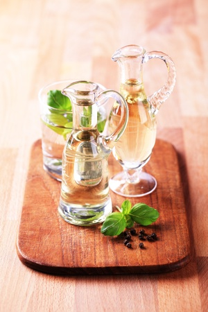 cooking oil: Bottles of cooking oil and vinegar - still life Stock Photo