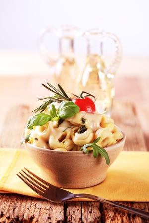 Bowl of tortellini with pesto and sauce photo