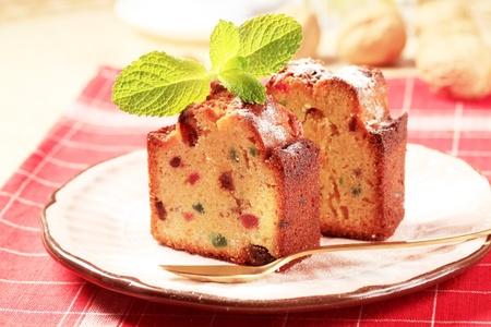 fruitcake: Slices of fruitcake garnished with mint sprig