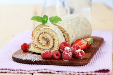 swiss roll: Swiss roll and fresh raspberries Stock Photo
