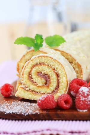Swiss roll glazed with white chocolate icing Stock Photo - 9148553