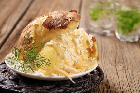 Baked potato with two kinds of cheese Stock Photo - 9148648