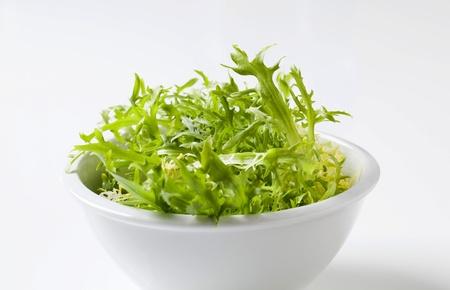 Bowl of fresh salad greens - closeup photo