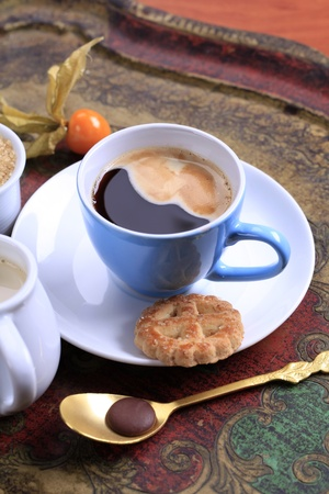 Cup of black coffee and biscuit - still life photo