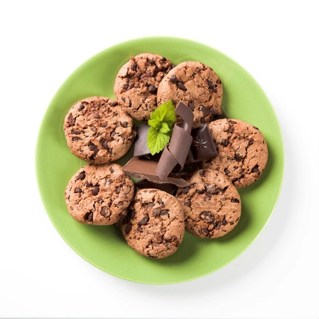 Chocolate chip cookies on a green plate - overhead Stock Photo - 9184556