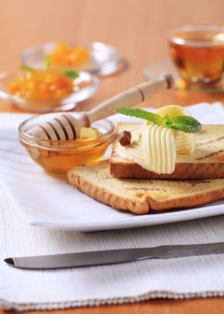 Breakfast - Toasted bread, butter, honey and jam photo