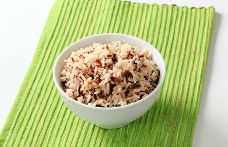 Bowl of cooked mixed rice - studio photo