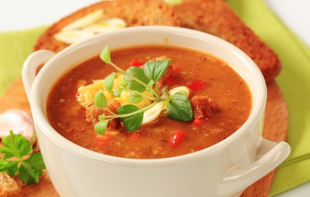 Cup of vegetarian goulash soup and fried bread photo
