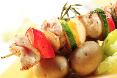 Chicken shish kebabs and new potatoes - detail Stock Photo - 9256323