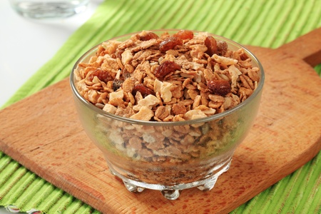 Bowl of mixed breakfast cereals and dried fruit photo