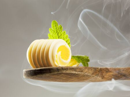 Butter curl on a wooden spoon in steam Stock Photo - 9360134