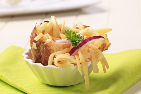 Baked potato sprinkled with grated edam cheese Stock Photo - 9391326