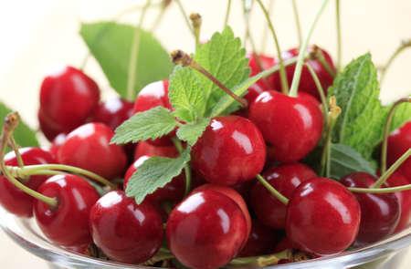 bing: Macro of freshly picked red cherries in a bowl
