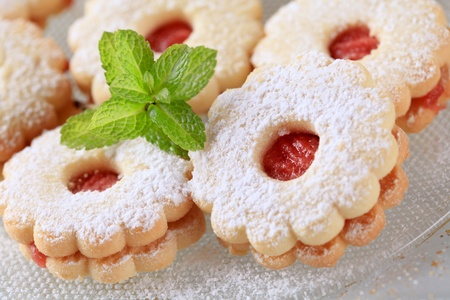 shortbread: Jam biscuits dusted with icing sugar - detail