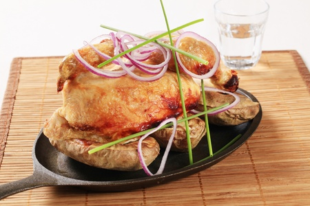 skillet: Roast chicken and potatoes on a skillet Stock Photo