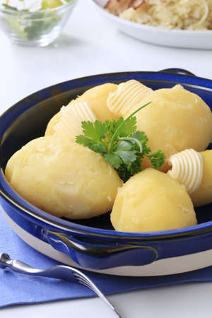 Side dish - Boiled potatoes with fresh butter photo
