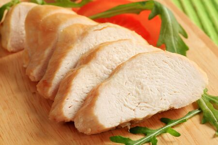 chicken breast: Sliced chicken breast fillet on a cutting board Stock Photo