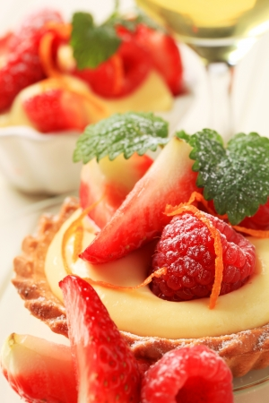Dessert - Small custard tart with fresh fruit Stock Photo