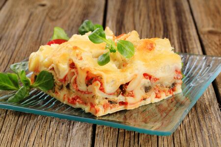 Portion of tasty lasagna on a plate Stock Photo