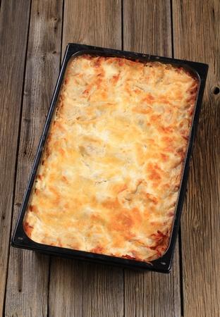 Ready lasagna in a baking pan photo