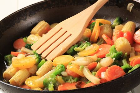 stir fry: Mixed vegetables prepared in a frying pan
