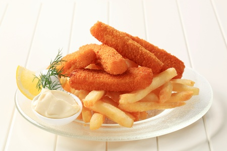 breaded: Fried fish sticks and French fries