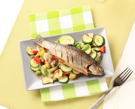 accompaniment: Grilled trout served with mixed vegetables Stock Photo