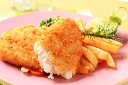 breaded: Fried fish served with French fries and mixed vegetables Stock Photo