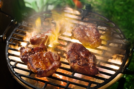 Grilling marinated meat on a charcoal grill