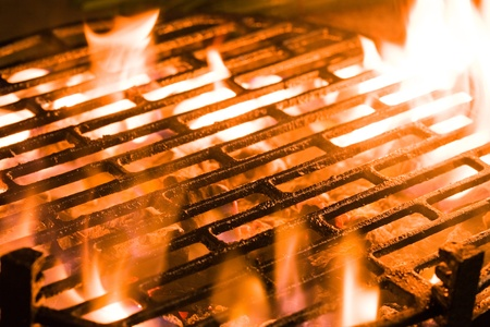 hot grill: Closeup of charcoal burning under a barbecue grill