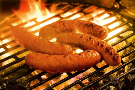 Barbecue - Grilling sausages on a charcoal grill photo