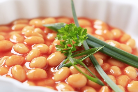Macro shot of baked beans in a casserole dish photo