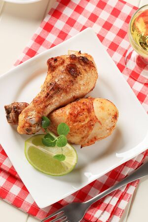entrees: Roasted chicken drumsticks with golden brown skin Stock Photo