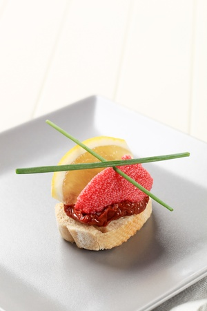 Bite-sized hors doeuvre - Red caviar canape photo