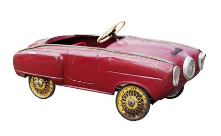 juguetes antiguos: Coche de juguete vintage rojo aislada en blanco