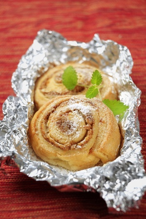 Danish pastries with nut filling in tinfoil photo