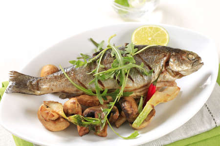 Pan fried trout served with button mushrooms  photo