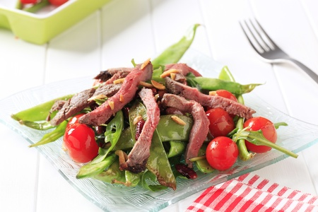 arugula: Strips of roast beef and sauteed vegetables