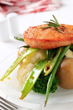 Marinated boneless pork chop served with vegetables Stock Photo - 10059415