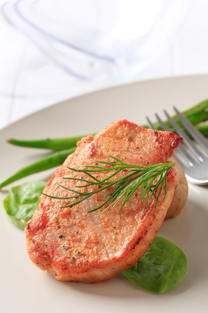 Marinated pork chop garnished with vegetables Stock Photo - 10059413