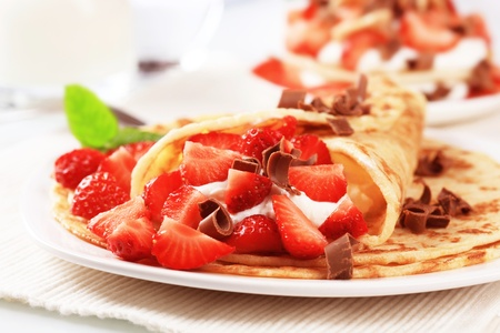 Crepes with sweet cheese and strawberries sprinkled with chocolate curls Stock Photo - 10102512