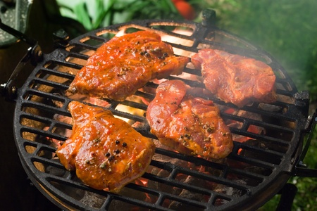 marinated: Grilling marinated meat on a charcoal grill