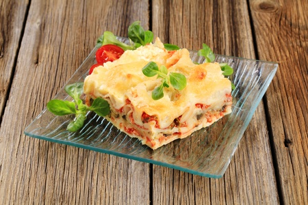 Portion of tasty lasagna on a plate photo