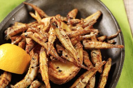 cast iron pan: Fried anchovies and potato on cast iron pan