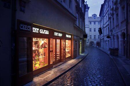 Illuminated souvenir shop in an old narrow street, Prague Stock Photo - 10451960