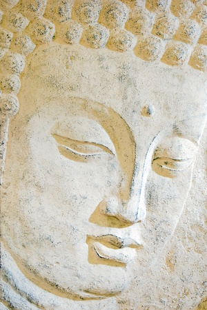 buddha head: Relief of a human face - closeup