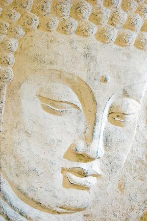 buddha head: Relief of a human face - closeup