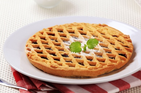 Homemade lattice topped tart with fruit filling photo